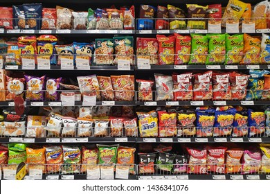 BANGKOK, THAILAND - APR 7, 2019: Various local brand of flavoured chips and snacks on store shelf in Siam Paragon Mall.