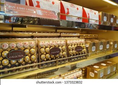 BANGKOK, THAILAND - APR 8, 2019: Ferrero Rocher premium chocolate on store shelf at Suvarnabhumi Airport. Ferrero Rocher is a spherical chocolate produced by the Italian chocolatier Ferrero SpA.