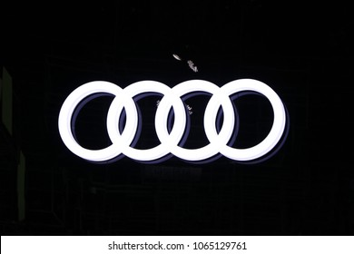 Bangkok, Thailand, April 05, 2018 : The light sign, die cut style of four Circular loop, Audi car's logo in the booth at Bangkok International Motor Show. Audi AG is a German automobile manufacturer.
