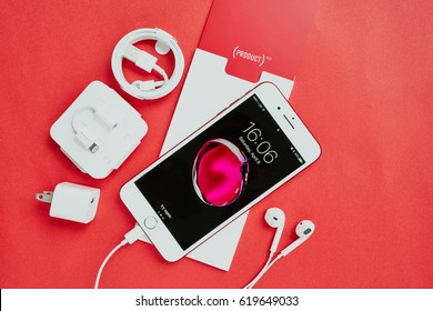BANGKOK, THAILAND - April 08, 2017: Special Edition RED color Apple product New iPhone 7 Plus front side lock screen and accessories on red background