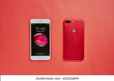 BANGKOK, THAILAND - April 08, 2017: Red product of Apple iPhone 7 Plus front side and backside on red background