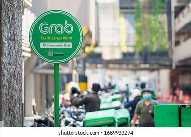 Bangkok, Thailand - April 1, 2020 : Signs Grab taxi pick-up point  at Central Ladprao after of the lockdown of Bangkok to stop pandemic of disease virus Covid-19 in Bangkok.
