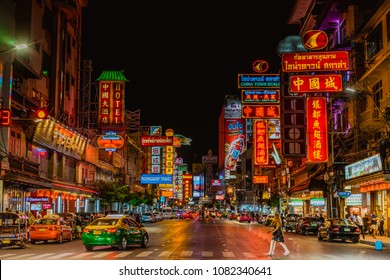 Bangkok, Thailand - April 10, 2017;Cars and shops on Yaowarat road. Chinatown with notable Chinese buildings, restaurants and decoration. Busy Yaowarat Road in the evening. chinese new year.