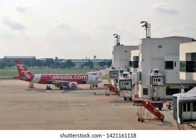 Bangkok, Thailand - April 10, 2019: Air Asia Airbus A320 preparing for the boarding bridge at Don Mueang International Airport.
