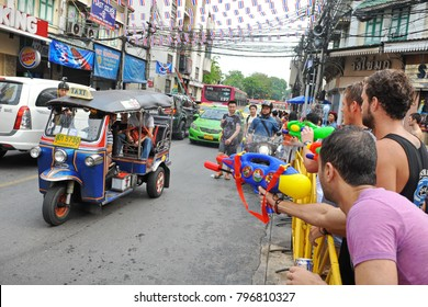 Bangkok, Thailand - April 12, 2013: Revelers enjoy water fights on Khao San Road during celebrations of Songkran. The Thai New Year is traditionally marked with the water fights and street parties.