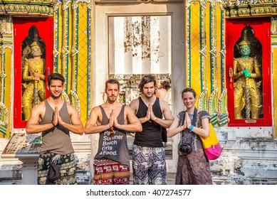 BANGKOK, THAILAND - APRIL 12, 2016 : Unidentified travelers posing Thai culture sawasdee(Hello or welcome) at Wat Pho in Bangkok, Thailand.