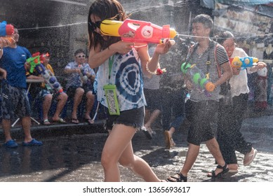 Bangkok, Thailand - April 12, 2018 : Tourists enjoy fighting with water gun on water festival at Khao San Road, Let's play with soaked together on Songkran's day in Bangkok