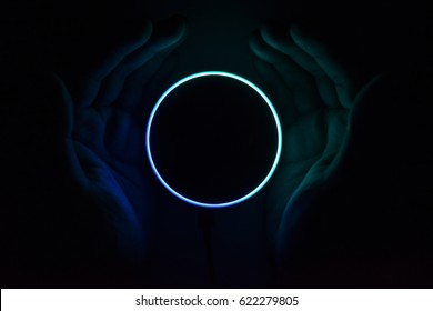 BANGKOK, THAILAND - April 12 : Hands and Amazon Echo dot version 2, the voice recognition streaming device from Amazon in dark room home on April 12 2017 in BANGKOK, THAILAND
