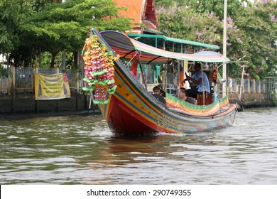 BANGKOK, THAILAND - APRIL 12: A traditional motorized long tail wooden Thai boat in the canal of Bangkok, Thailand on the 12th April, 2015.