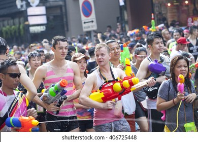 BANGKOK, THAILAND - APRIL 13, 2016: people playing water in Songkran festival on April 13, 2016 at Silom Road in Bangkok.