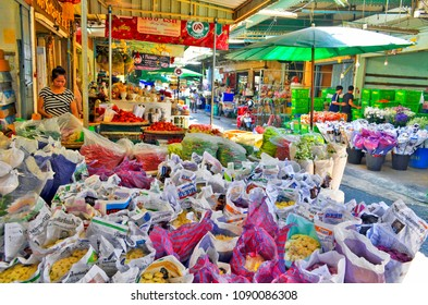 Bangkok, Thailand, April 13, 2017 - Flower vendor stall at the ICP Flower Market of Chinatown, a wholesale and retail fresh flower market in Bangkok.