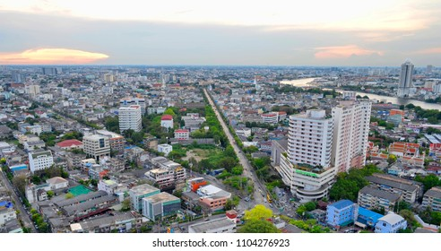 Bangkok, Thailand, April 13, 2017 - View of Thonburi, the Chao Phraya river and Rattanakosin at dusk from a rooftop bar.