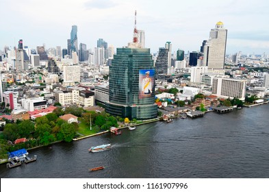 Bangkok, Thailand - April 13, 2017: Silom and Sathorn buildings and the Chao Phraya river from a rooftop bar.