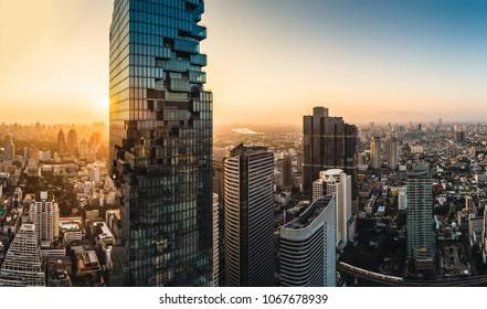 Bangkok / Thailand - April 13 2018: A view of The Chao Phraya River from behind The MahaNakon Tower.