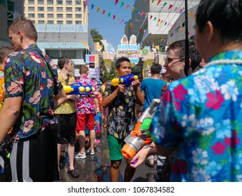 Bangkok Thailand . April 13 - 2018 : Thai children's and tourist play water on the road in Songkran festival, happy family day, Bangkok Thailand.