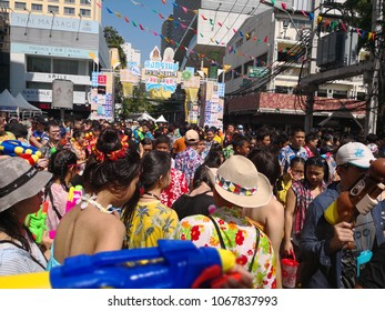 Bangkok, Thailand - April 13, 2018 : Tourist enjoy with fighting water gun of water festival in Silom Road, Let's play with soaked together, super splash with sunshine flare