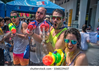 Bangkok, Thailand - April 13, 2018 : Tourists happiness fighting with water gun on the second day of water festival in Khao San Road, Let's play with soaked together on Songkran's in  Bangkok