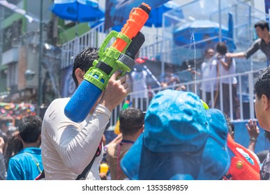 Bangkok, Thailand - April 13, 2018 : Tourist happiness fighting with water gun in water festival in Khao San Road, Let's play with splash together in Songkran Festival Bangkok