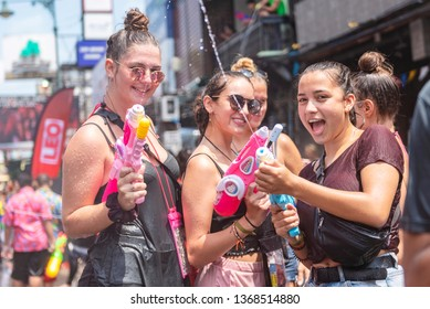 Bangkok, Thailand - April 13, 2019 : Tourists happiness fighting with water gun in water festival at Khao San Road, Let's play with splash together in Songkran Festival Bangkok