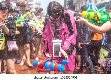 Bangkok, Thailand - April 13, 2019 : Young a  girl is under fire by water gun in Songkran Festival at  Khao San Road
