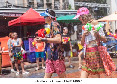 Bangkok, Thailand - April 13, 2019 : Tourists happiness fighting with water gun in water festival in Khao San Road, Let's play with splash together in Songkran Festival Bangkok
