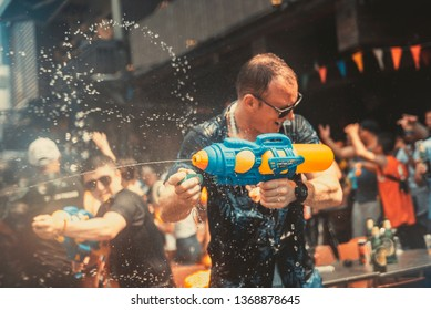 Bangkok, Thailand - April 13, 2019 Tourists enjoy fighting with water gun on water festival at Khao San Road, Let's play with soaked together on Songkran's day in Bangkok