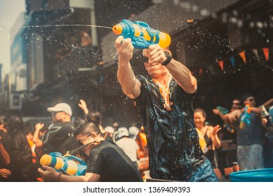 Bangkok, Thailand - April 13, 2019 : Tourists enjoy fighting with water gun on water festival at Khao San Road, Let's play with soaked together on Songkran's day in Bangkok