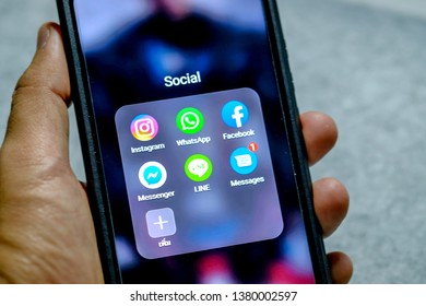 Bangkok, Thailand - April 13, 2019: IPhone x showing its screen with Facebook, WhatsApp, Messenger and Instagram application icons.