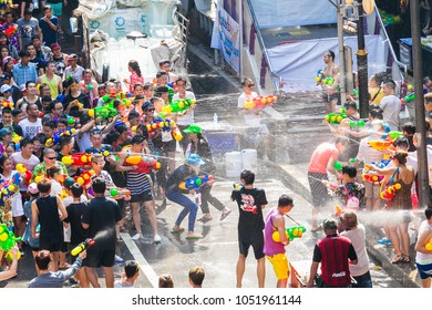 BANGKOK, THAILAND - April 13: Famous Songkran Festival in Silom on April 13, 2017. One of the most popular water fight places during Songkran in Bangkok, Thailand.