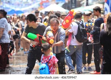 Bangkok, Thailand - April 13: Tourists shooting water guns and having fun at Songkran festival, the traditional Thai New Year, on Khao San Road in Bangkok, Thailand.