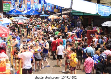 "BANGKOK, THAILAND - APRIL 13: Unidentified Thai and International people enjoy in ""Bangkok Songkran Festival 2013 (Thailand new year)"" at Khao san Road on April 13, 2013 in Bangkok, Thailand"