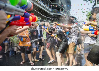 Bangkok, Thailand - April 14, 2016 : Let's play with splash of water gun each other in Songkran Festival at Silom Road