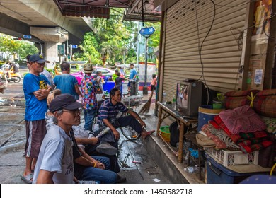 Bangkok, Thailand - April 14, 2019: Local people watching sports on TV on the street
