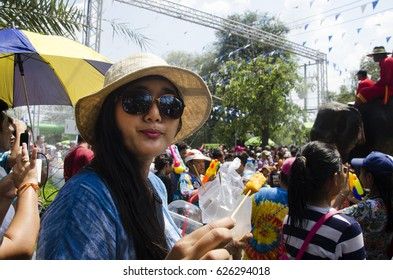 BANGKOK, THAILAND - APRIL 14 : Thai people and foreigner travelers playing and splashing water with women eating food in Songkran Festival at Ayutthaya city on April 14, 2017 in Ayutthaya, Thailand