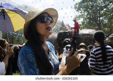 BANGKOK, THAILAND - APRIL 14 : Traveler thai woman posing and travel join with  Songkran Festival is celebrated in a traditional thai New Year at Ayutthaya city on April 14, 2017 in Ayutthaya,Thailand