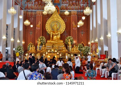 Bangkok, Thailand - April 15, 2017: Worshippers and monks during a ceremony at the Wat Chana Songkhram Rachawora Mahawiharn.