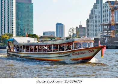 Bangkok, Thailand - April 15, 2017: Orange Flag Line water bus of the Chao Phraya Express Boat public company.