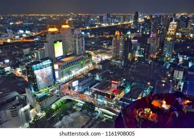Bangkok, Thailand - April 15, 2017: Pratunam buildings by night from a rooftop bar.
