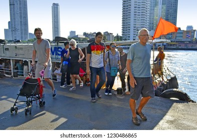 Bangkok, Thailand - April 15, 2017: Passengers getting off the Orange Flag Line bus boat of the Chao Phraya Express Boat Company at Sathorn Pier.