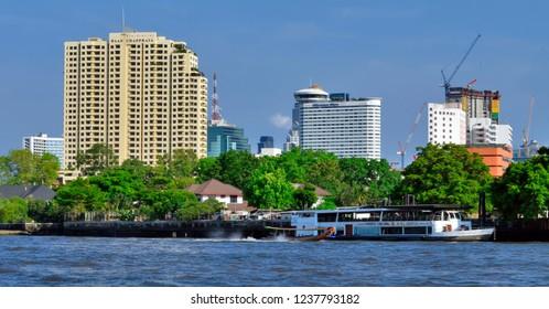 Bangkok, Thailand - April 15, 2017: Along the Chao Phraya River on the right riverbank.