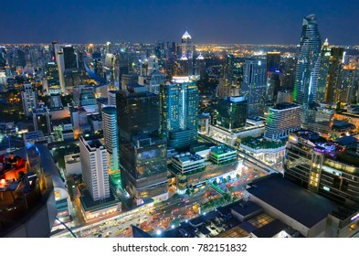 Bangkok, Thailand - April 15, 2017. Siam and Sukhumvit buildings by night from a rooftop bar.