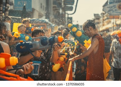 Bangkok, Thailand - April 15, 2019 : Tourists enjoy fighting with water gun on water festival at Khao San Road, Let's play with soaked together on Songkran's day in Bangkok