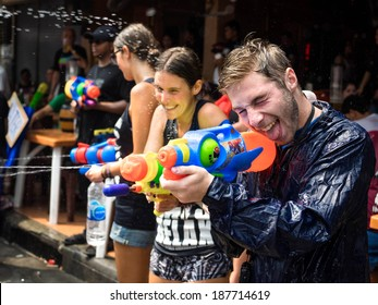 Bangkok, Thailand - April 15: Tourists shooting water guns and having fun at Songkran festival, the traditional Thai New Year, on Khao San Road in Bangkok, Thailand.