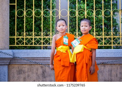 BANGKOK, THAILAND – APRIL 15: Two novices dressed in orange cloth on the chest. A boy who was ordained in the novice ordination program on April 15, 2017 in Bangkok, Thailand.