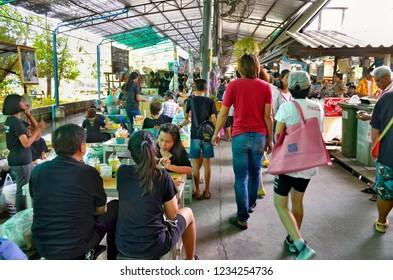 Bangkok, Thailand, April 16, 2017 - Bangkokian families enjoying a meal at one of the many restaurants at Bang Nam Phueng floating market.