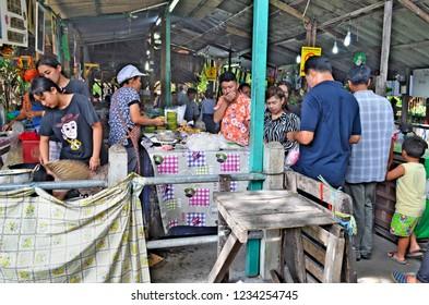 Bangkok, Thailand, April 16, 2017 - Bangkokian families wandering in the food and drink aisles of Bang Nam Phueng floating market on a week-end.