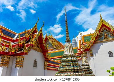 Bangkok, Thailand - April 17, 2019: In the enclosure of the Wat Pho, the temple of the Reclining Buddha on sky background. decoration image contain certain grain noise and soft focus.