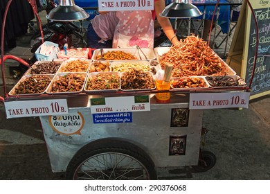 Bangkok, Thailand - April 17,2015: A street vendor selling fried insects to tourists on Khao San Road in Bangkok