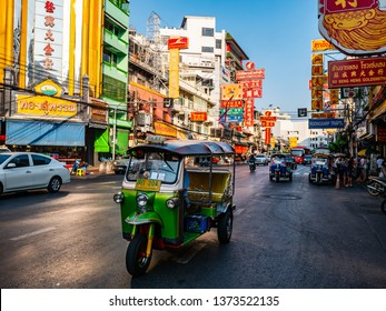 BANGKOK ,THAILAND - April 18 2019 : Tutu taxi car driving in Chinatown road for send passeger to another place in Bangkok,Thailand.
