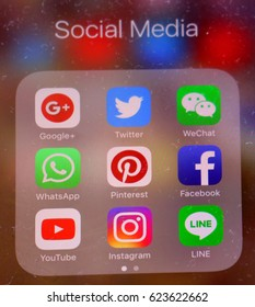 BANGKOK, THAILAND - APRIL 19, 2017 : Iphone with icons of social media on screen close up, smartphone life style, smartphone era, Social media application concept